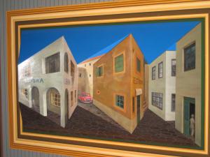見ているとクラクラするんだよね。タネは三枚目の写真でわかるように建物の角が飛び出しているように作ってある立体アートなんです
